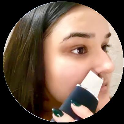 Girl using Ultrasonic Face Scrubber - Deep Cleansing